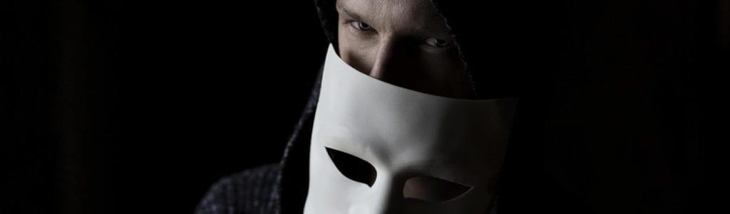 Scammer behind Mask